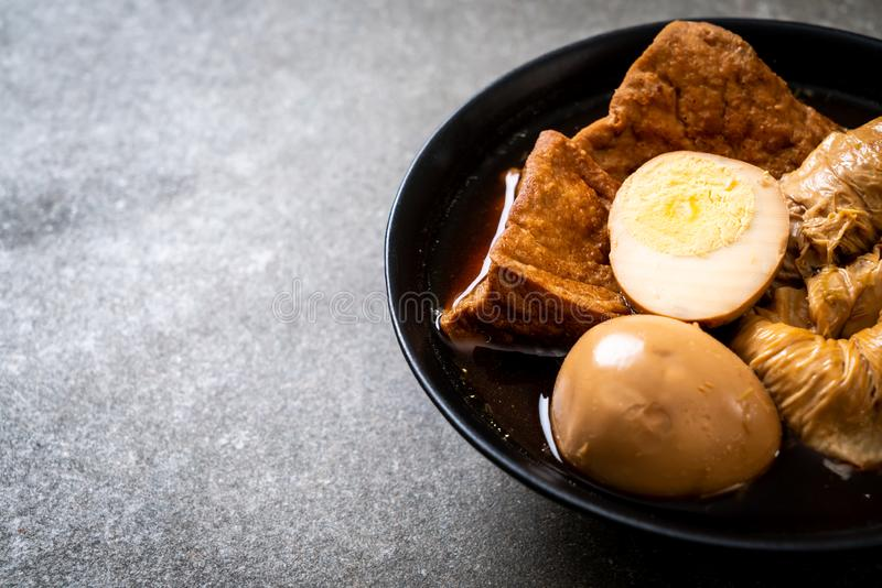 Hard-boiled egg in brown sauce or sweet gravy. Asian food royalty free stock photos