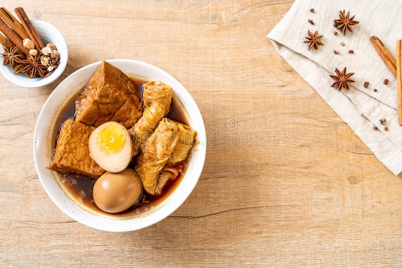 Hard-boiled egg in brown sauce or sweet gravy. Asian food royalty free stock images