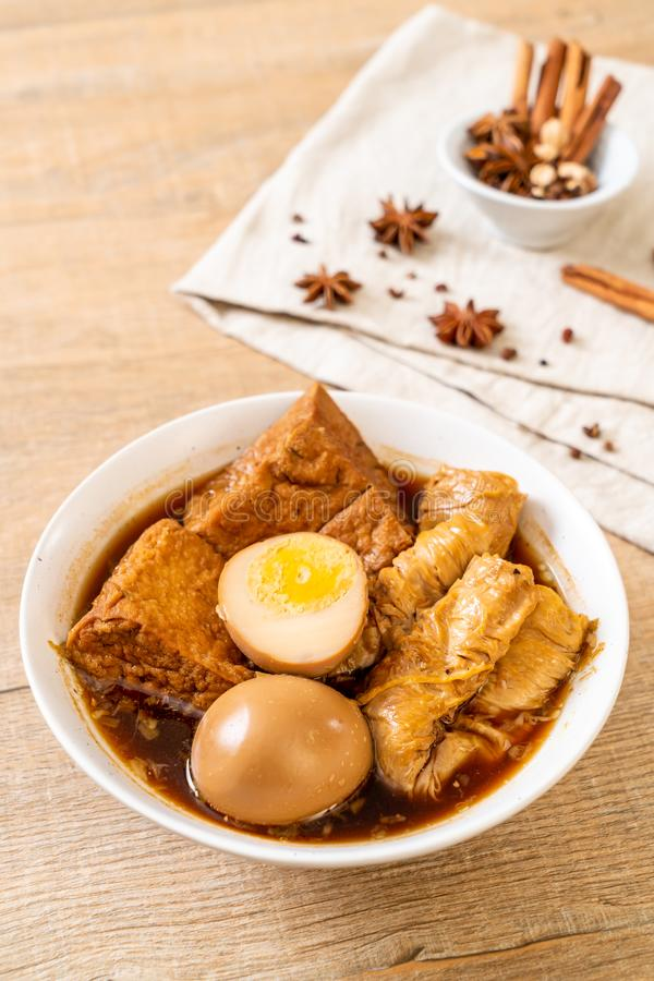 Hard-boiled egg in brown sauce or sweet gravy. Asian food stock photography