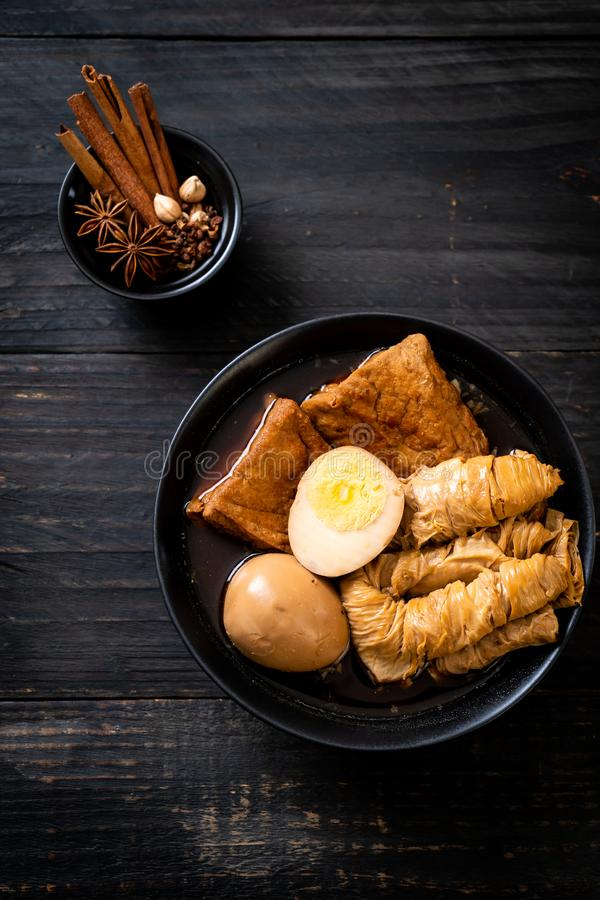 Hard-boiled egg in brown sauce or sweet gravy. Asian food stock image