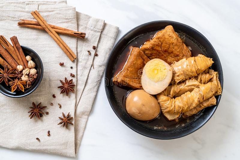 Hard-boiled egg in brown sauce or sweet gravy. Asian food stock photos