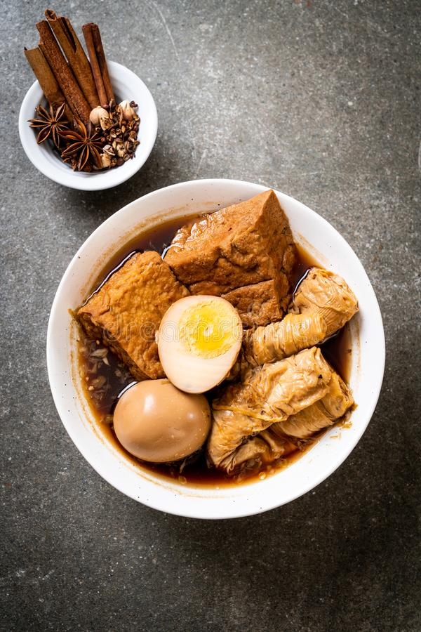 Hard-boiled egg in brown sauce or sweet gravy. Asian food royalty free stock photo
