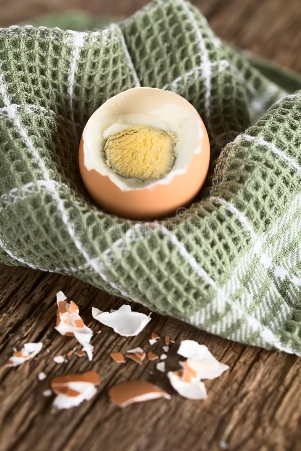 Hard-Boiled Egg. In kitchen towel Very Shallow Depth of Field, Focus through the middle of the egg yolk royalty free stock photos