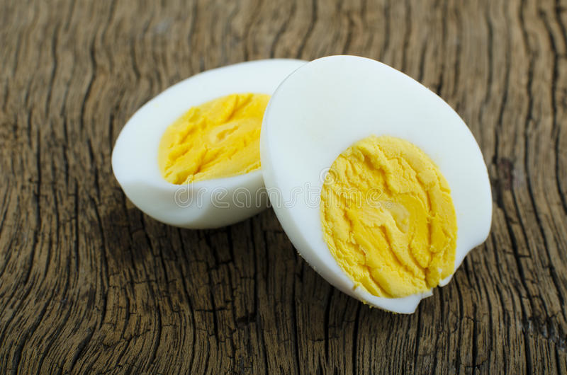 A hard boiled egg sliced in two ready to be eaten. stock images