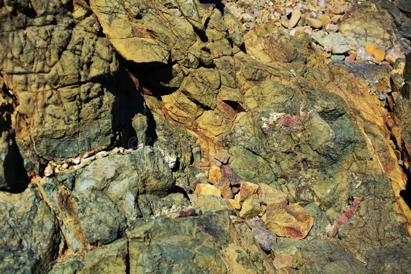 Hard brown rocks, landscape. Stone, rocks background royalty free stock photos
