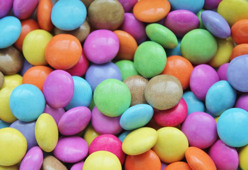 Hard candy smarties sweets stock, photo, photograph, image, picture. Bright coloured hard shelled candy ready for snacks or Halloween full screen, stock, photo stock photos