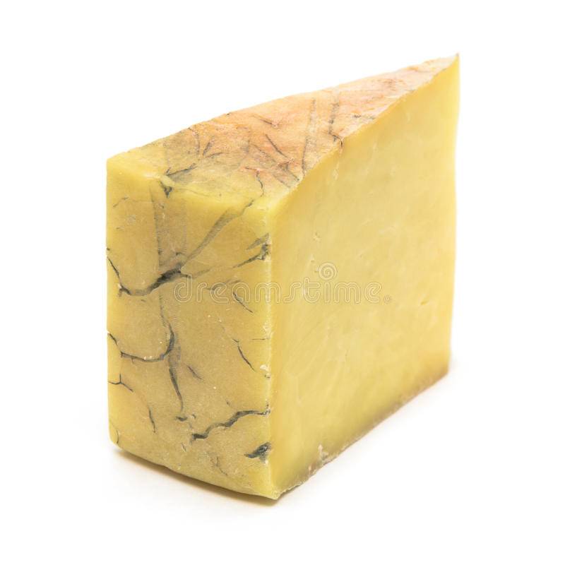 Hard Cheese. A sliced wedge of hard yellow cheese, isolated on white stock image