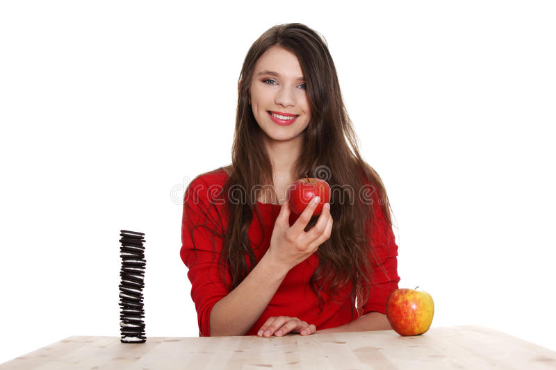 Hard choice. Girl does not know what to eat royalty free stock photo