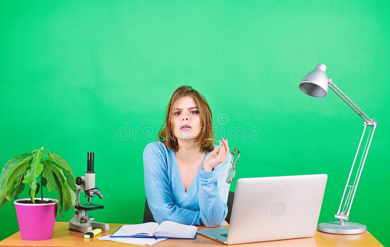 Hard choice to make. tired secretary at workplace. digital science. businesswoman. data and information. chemist. Biologist with microscope on table. woman work stock photos