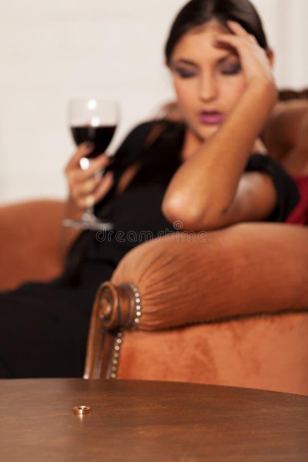 Hard decision to make. Girl taking a hard decision; focus on wedding ring stock photos
