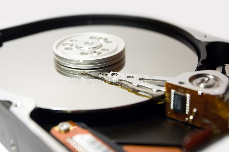 Hard disc. Detail isolated over white background stock photography