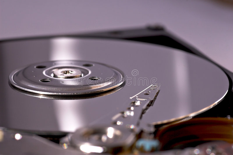 Hard disk drive. Exposed laptop hard disk drive head and platter stock photos