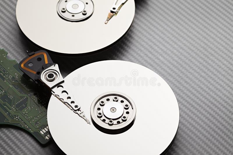 Hard disk drive on carbon fiber background stock photo