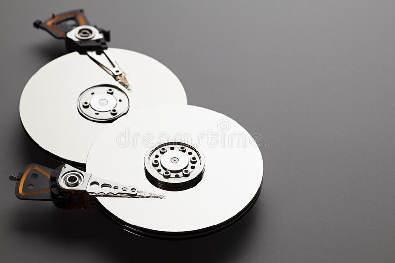 Hard disk drive on carbon fiber background royalty free stock photography