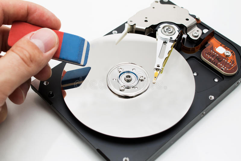 Hard disk drive data erase metaphor stock photography