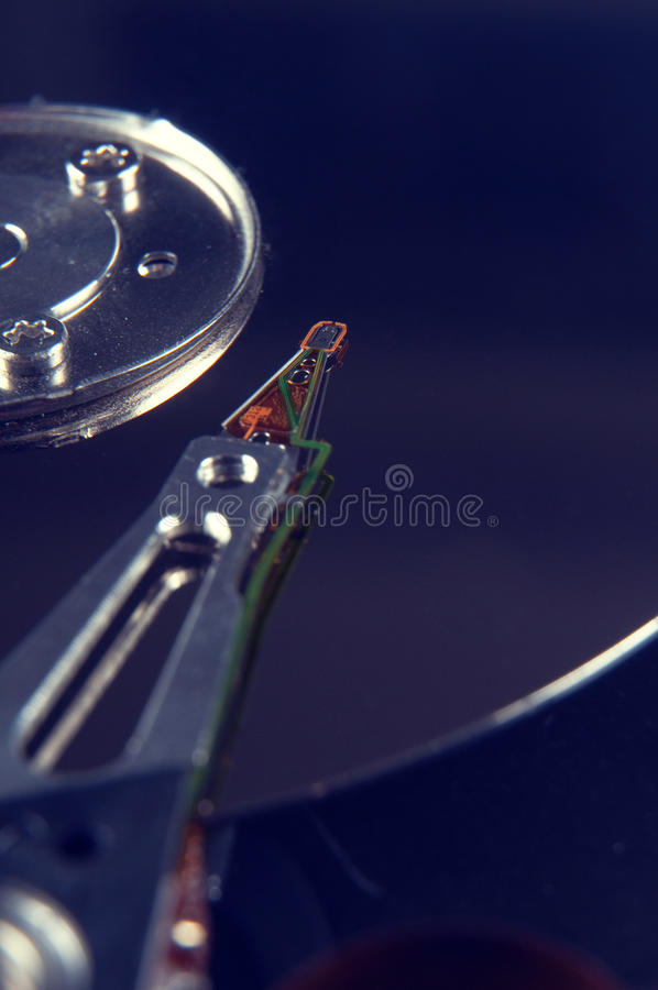 Hard disk drive detail. Closeup of an opened hard disk drive stock image