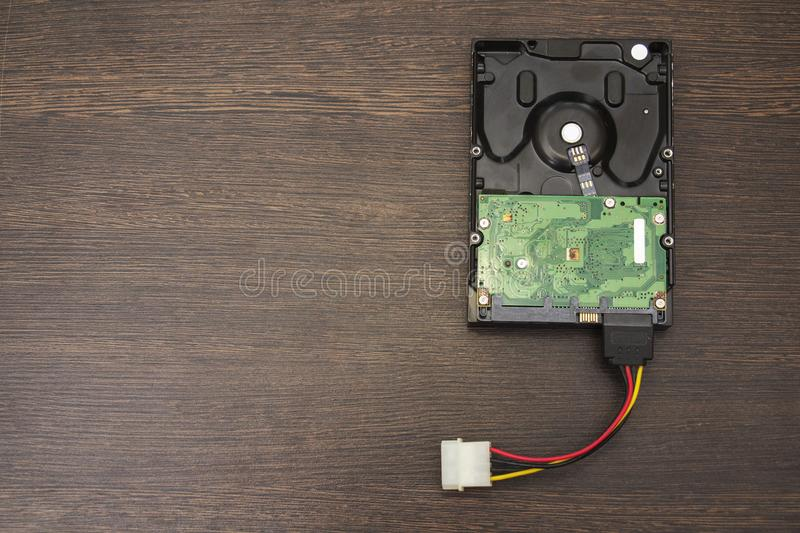 Hard disk drive. Hard disk on a wooden table stock images
