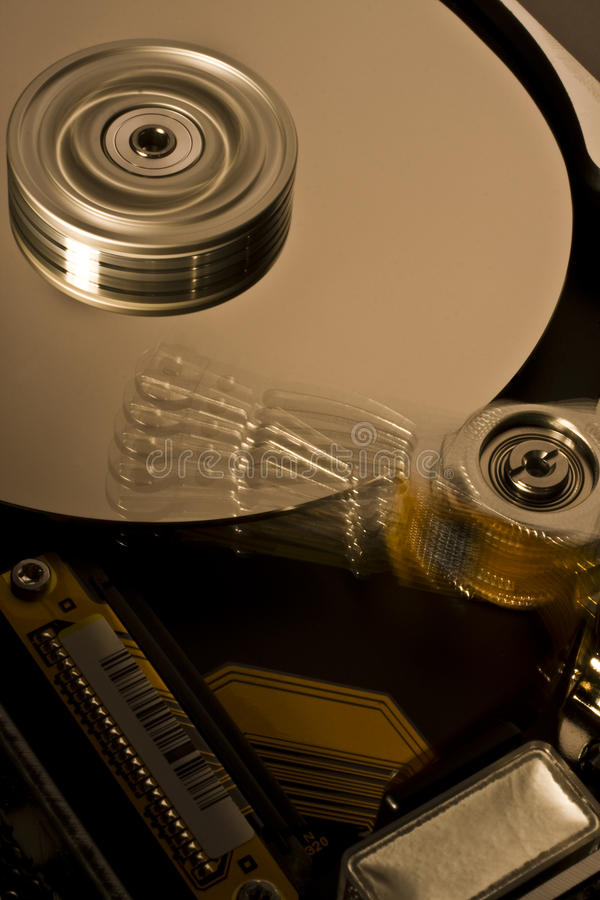 Hard disk drive in motion - four royalty free stock image