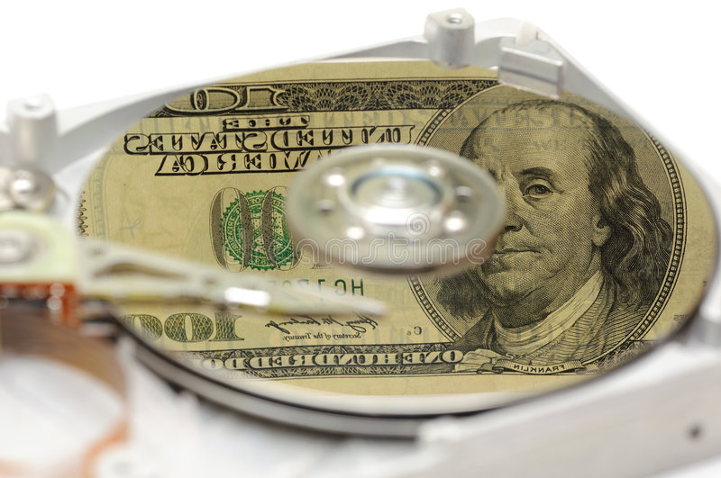 Hard Disk Drive With US Money Reflection Stock Photos