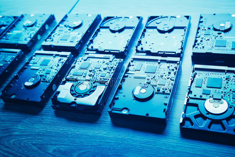 Hard disk drives in a rows. Blue tone stock image