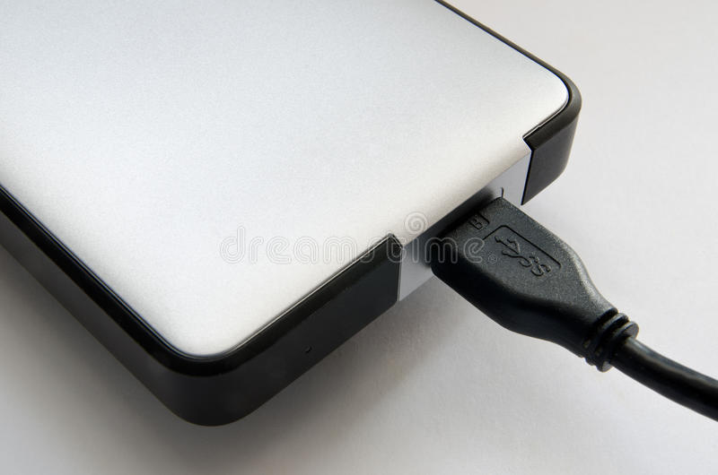 Hard disk. On a grey background closeup royalty free stock image