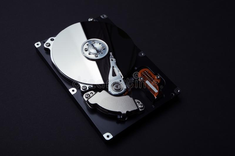 Hard disk internal mechanism hardware. Cyber surveillance and identity theft of users stock images