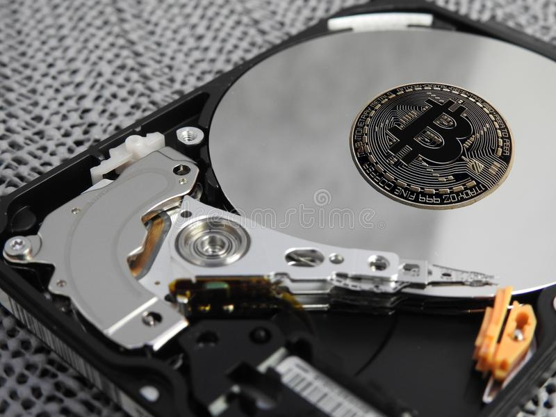 Hard drive and Bitcoin royalty free stock photography