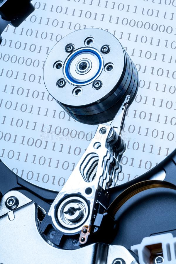 Hard Disk Drive with Binary Code Reflections. Hard drive bytes drive hard disk drive hdd hard disk fixed stock photos