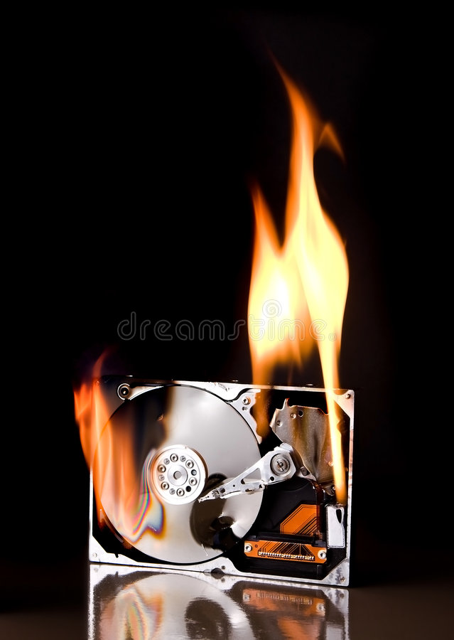 Hard drive on fire royalty free stock photography