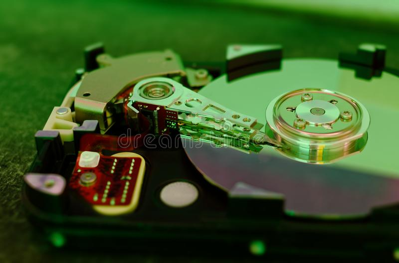 Hard drive 3.5 inches as a data storage with motherboard on a bamboo table.  stock images