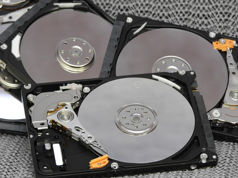 Hard drives. Open hard drives with view of write read parts stock photo
