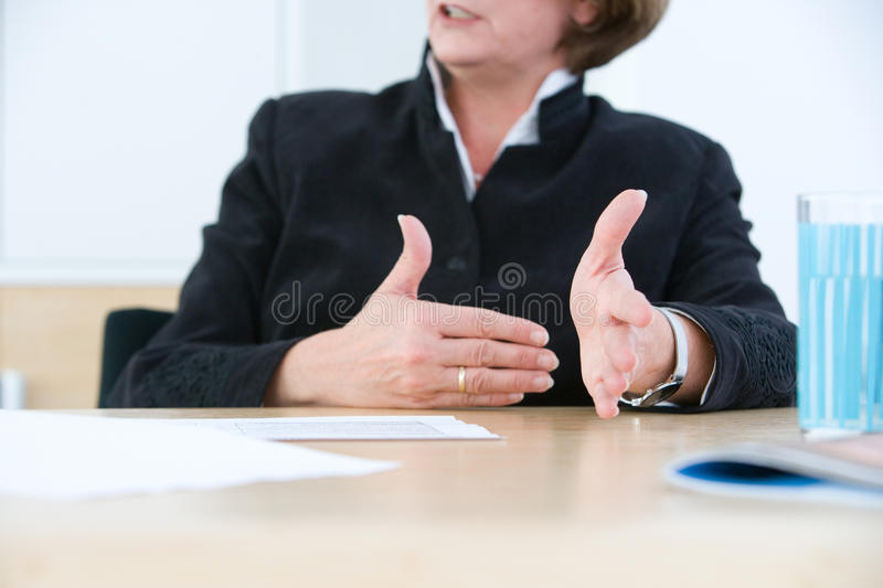 Hard facts. Managing woman declaims the hard facts with hands royalty free stock image