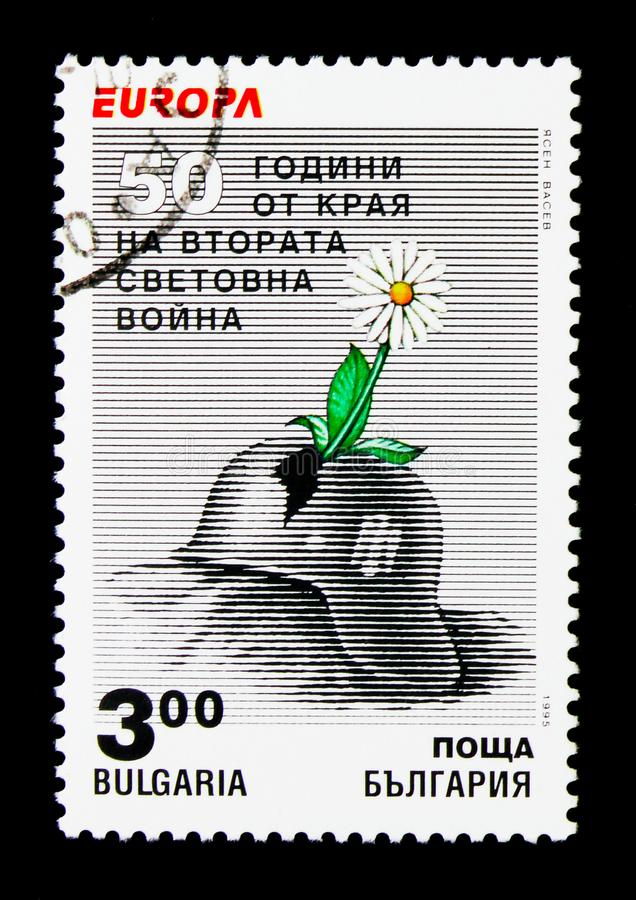 Hard hat and flower, Peace and freedom, Europa (C.E.P.T.) 1995 s. MOSCOW, RUSSIA - NOVEMBER 25, 2017: A stamp printed in Bulgaria shows Hard hat and stock photo