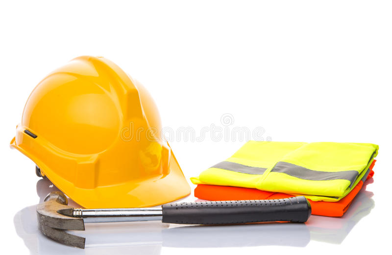 Hard Hat,Hammer and Reflective Vest V. Yellow hard hat, a hammer and orange and yellow reflective vest over white background stock photography