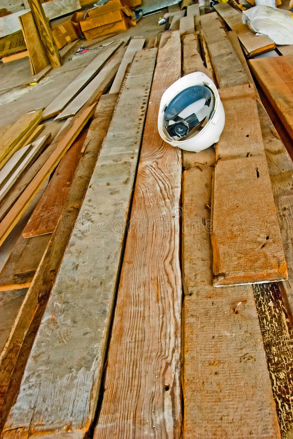 Download A hard hat on wood planks stock photo. Image of safety - 12881420