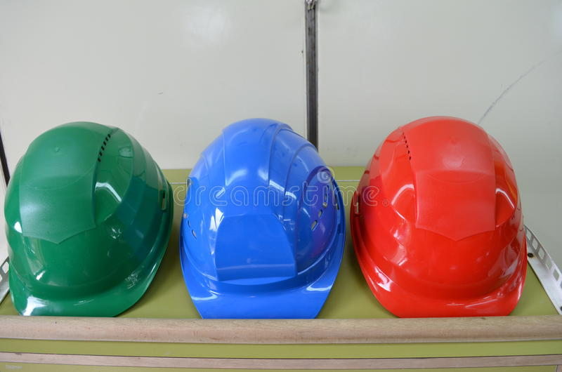 Hard hats lying on a storage rack royalty free stock photos