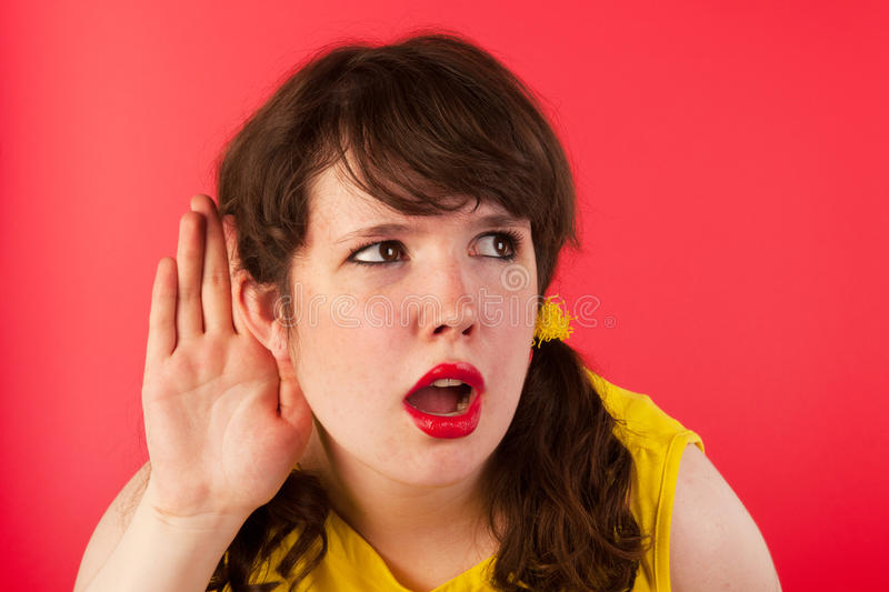 Hard of hearing. Young girl cannnot hearing what you say stock photography