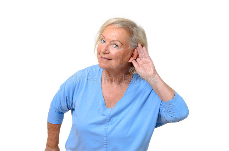 Hard of hearing attractive elderly woman royalty free stock photos