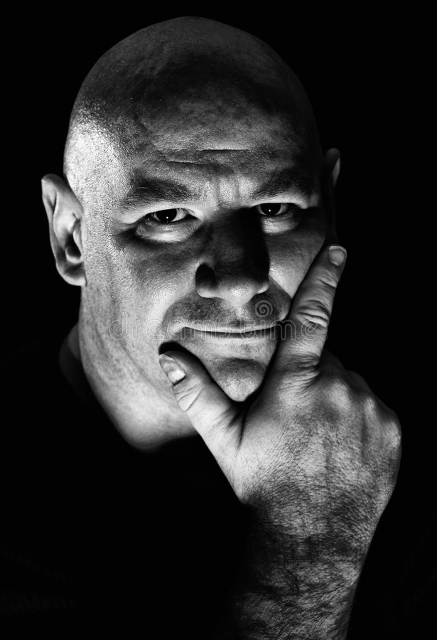 Hard light portrait of middle aged man stock photography