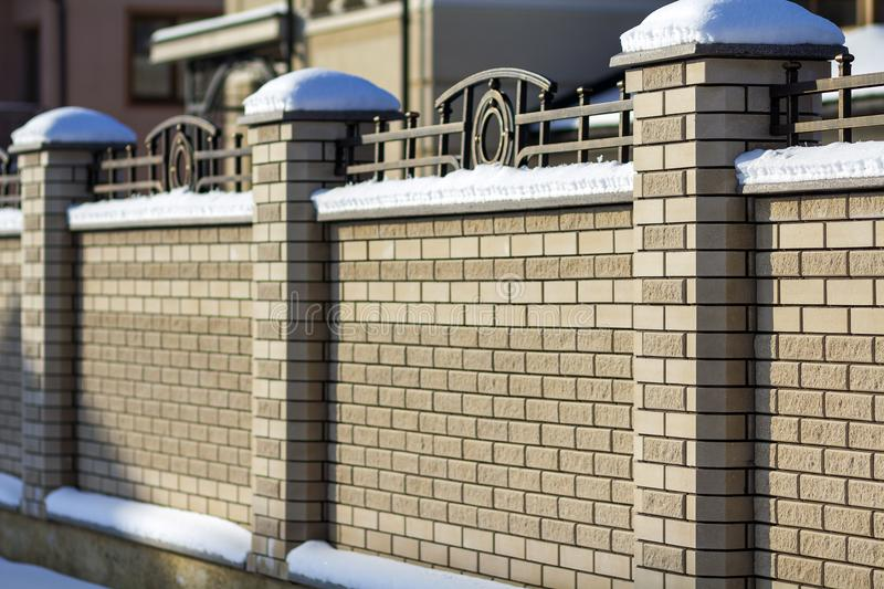 Hard long solid rural fence made from aged white bricks. stock photography