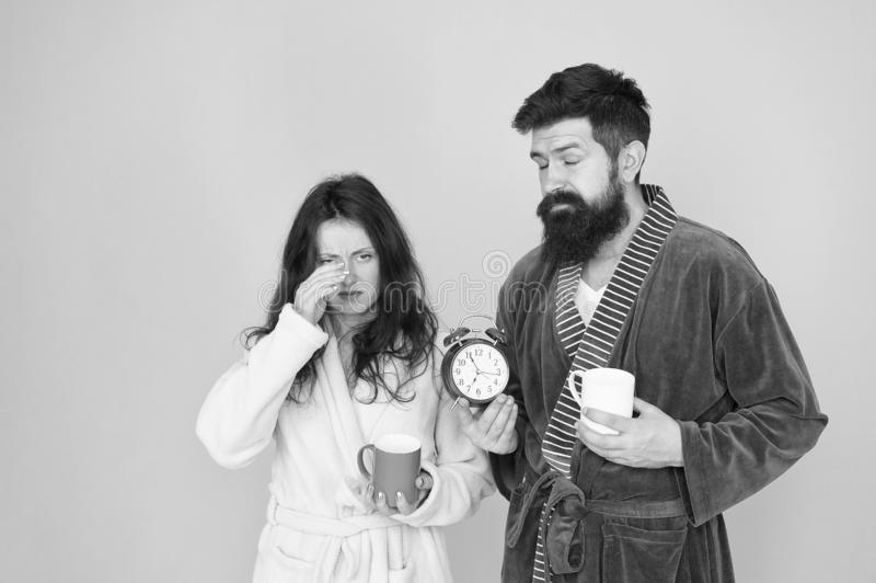 Hard morning. Sleepy people. morning couple drink coffee. bearded man and girl coffee cup. wake up time. family life royalty free stock image