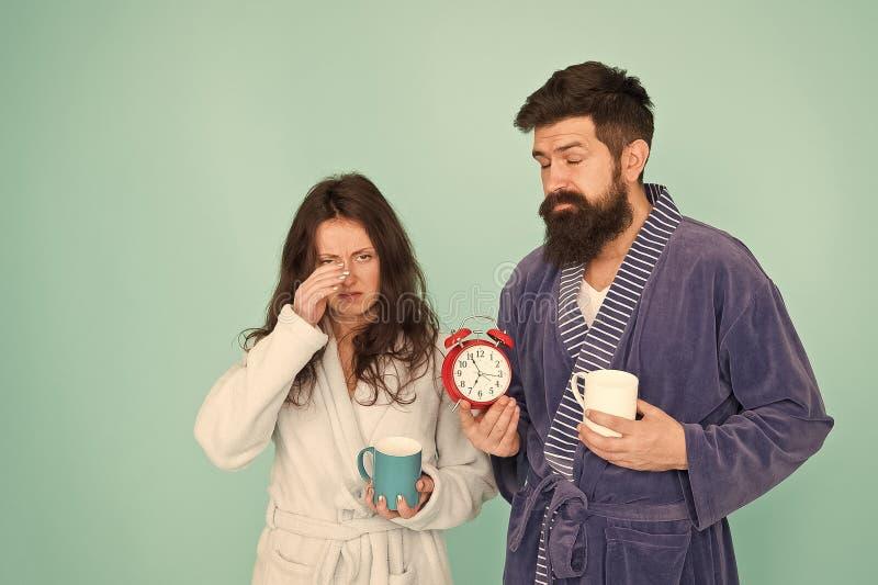 Hard morning. Sleepy people. morning couple drink coffee. bearded man and girl coffee cup. wake up time. family life. Hard morning. Sleepy people. morning couple stock image