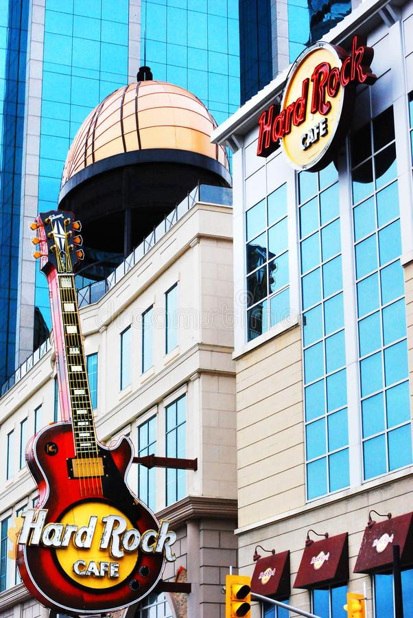 Hard Rock Cafe guitar, high rise buildings Niagara Falls, Canada. The very popular tourist eating and meeting place around the world, the Hard Rock Cafe in