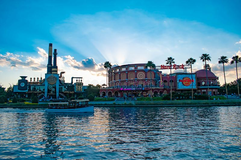 Hard Rock Cafe on sunset background at Universal Orlando Resort in Florida with the lake on the foreground.  2 stock image