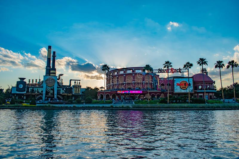 Hard Rock Cafe on sunset background at Universal Orlando Resort in Florida with the lake on the foreground.  3 stock photography