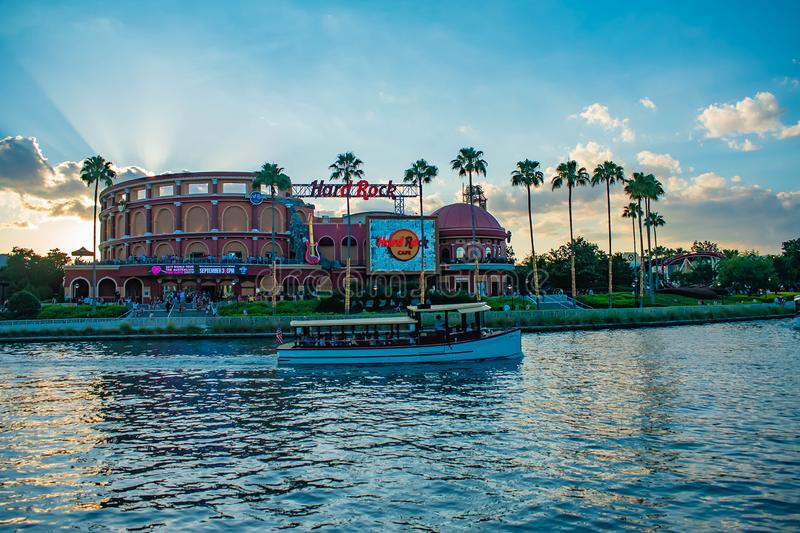Hard Rock Cafe on sunset background at Universal Orlando Resort in Florida with the lake on the foreground.  1 stock image