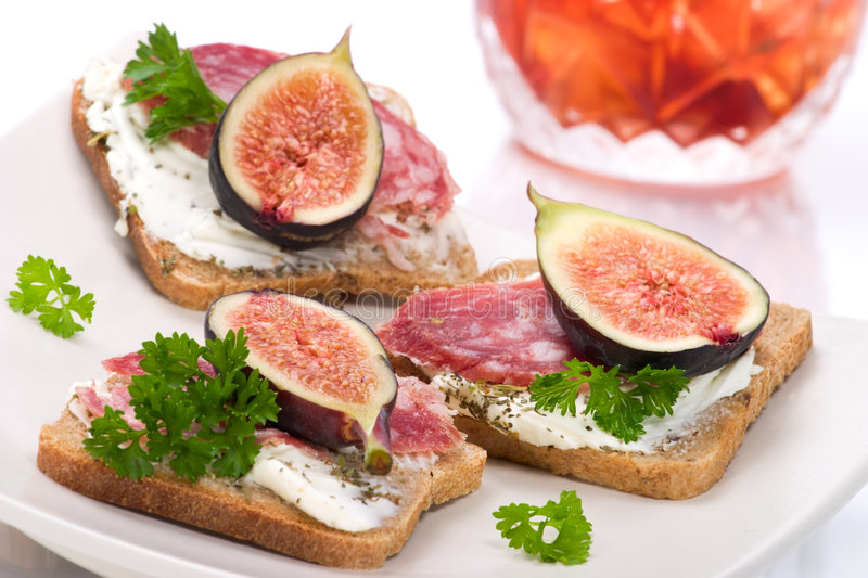 Hard salami with figs canapes royalty free stock image
