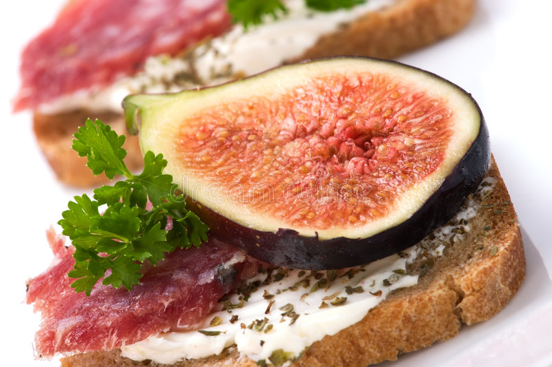Hard salami with figs canapes stock photography