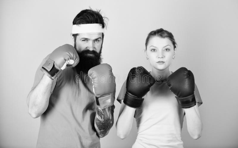 It is hard to fail. training with coach. knockout and energy. couple training in boxing gloves. punching, sport Success. Sportswear. Fight. Happy woman and stock images