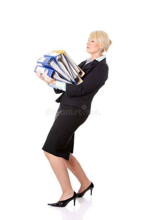 Hard werken van de rijpe het bedrijfsvrouw. stock foto's